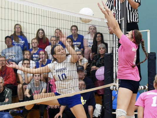 Waynesboro's Olivia Fogelsonger, left, tries to defend a block from Greencastle-Antrim's Jess Root on Thursday. The Maidens won, 3-2, and clinched the Mid Penn Capital Division crown for the second year in a row.
