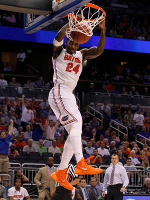 Florida Gators forward Casey Prather (24) dunks against the Albany Great Danes during the second half of a men's college basketball game during the second round of the 2014 NCAA Tournament at Amway Center.