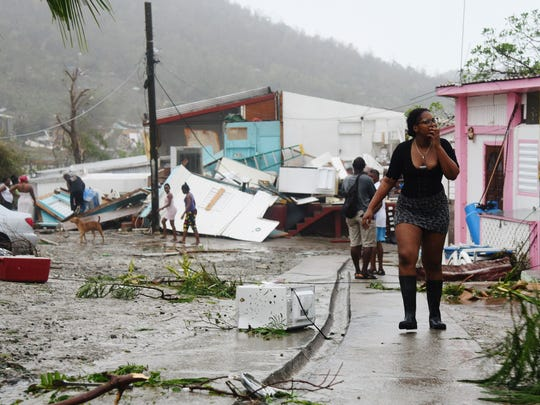 Hurricane Irma pummeled St. Maarten/St. Martin and other northern Caribbean islands Wednesday as it tore a disastrous path through the Atlantic toward the continental U.S. Here, a young woman gasps as she explores the damage in Cay Bay, a largely immigrant community on the island's south east, during a lull in the storm early Wednesday. The storm picked up again an hour later, causing more havoc. (D.A. Robin/Special to the Democrat)