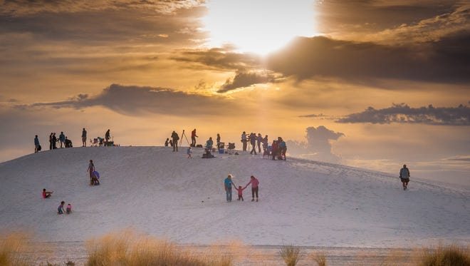 Visitors gather for an early morning event at  White Sands National Monument. Whether your destination is a day trip or a vacation at a distant location, making sure you're prepared for the climate and activities will enhance your getaway.