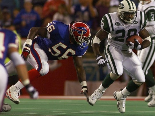 Bills linebacker Sam Cowart, shown pursuing Jets running back Curtis Martin during a Buffalo victory, was a second round pick in 1999.