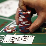 A dealer handles chips at Sands Casino Resort Bethlehem in Bethlehem, Pa.