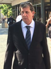 Ron Ilitch, 57, leaves the Frank Murphy Hall of Justice