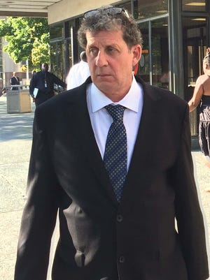 Ron Ilitch, 57, leaves the Frank Murphy Hall of Justice in Detroit on Sept. 4, 2014.