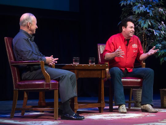 John Schnatter, right, founder and CEO of Papa John's, fields questions from the audience Tuesday in Loeb Playhouse during a Q&A with Purdue President Mitch Daniels.