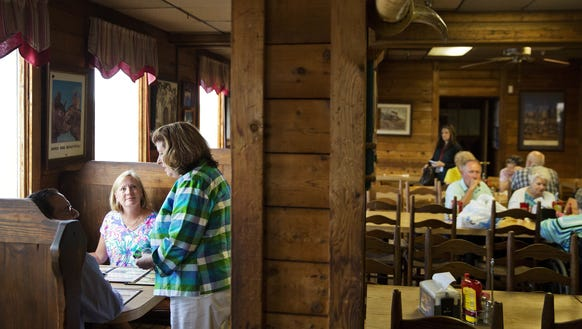 Karen Handel talks with diners during a campaign stop