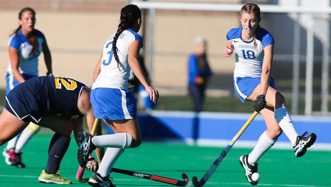 Blue Hens Maura Zarkoski (#18) tries to block a shot in the first half Wednesday, November 12, 2014 at Rullo Stadium.