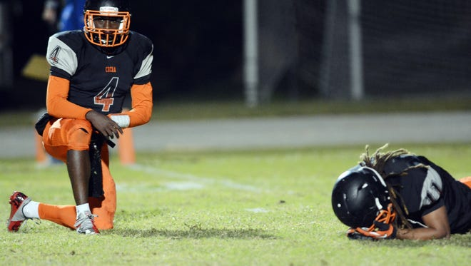 Cocoa's Bruce Judson (4) and Kevin Troutman remain on the field after Cocoa's 14-12 loss to Miami BTW last year.