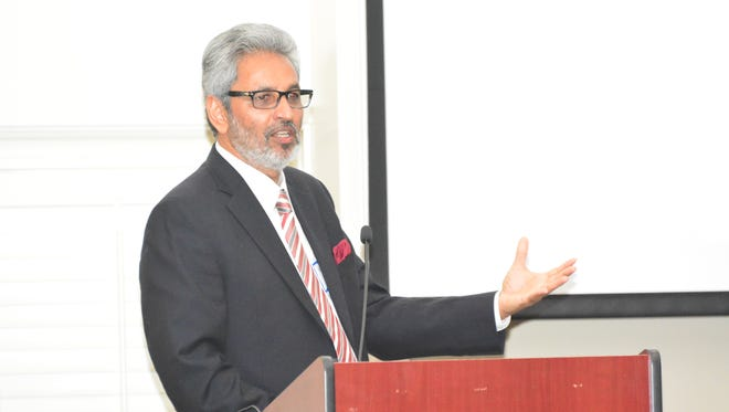 Bawa Jain, founding Secretary General of The World Council of Religious Leaders, speaks at the Peace and Conflict Resolution Seminar hosted by Greenville Rotary.