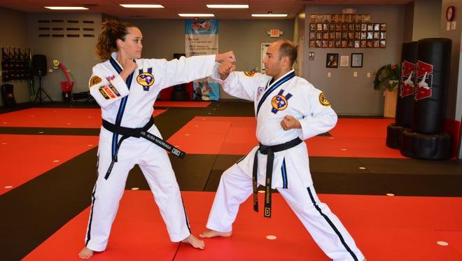 Lorea Ausa and her husband, Daniel Madriaga, own ATA Black Belt Attitude karate schools in Greenville County.