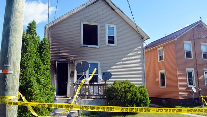 Police tape surrounds the site of an early-morning house fire in Two Rivers on Thursday. Police reported one death and at least $50,000 worth of damage occurred during the fire.