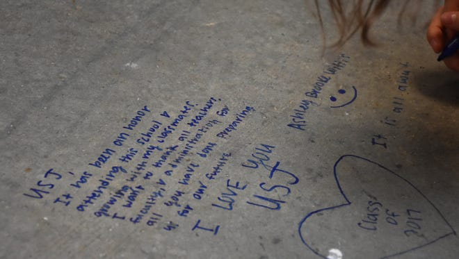 Members of the University School of Jackson Class of 2017 signed the concrete under new carpet, since they were the first class to start kindergarten at the lower school's building.