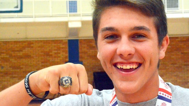 Carlsbad's Nate Arrington sports his 6A state championship ring on Friday.