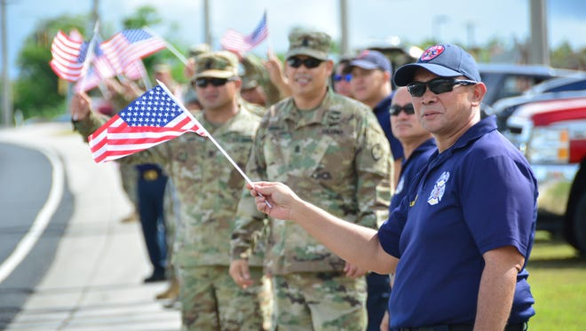 Members of the Guam Guard's 94th Civil Support Team and the Guam Fire Department honored the 15th anniversary of the 9/11 attacks at a wave and sounding of sirens at the Guard's Barrigada Readiness Center on Sep. 11, 2016. (Photo provided courtesy of First Lt. Mark Scott, Acting Public Affairs Officer for the Guam National Guard, Released.)