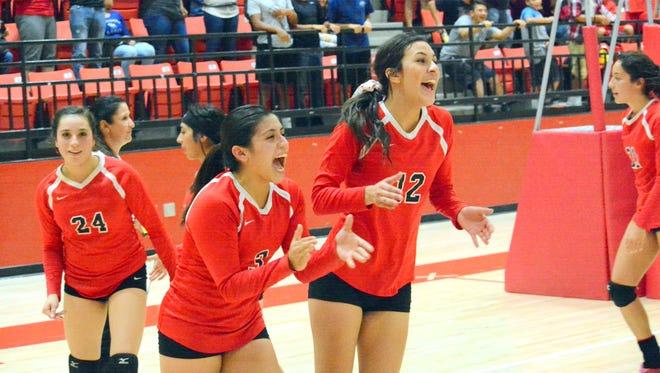 Loving's Cassandra Calderon (3) and Katelynn Rubio (12) celebrate Tuesday's district tournament quarterfinals win over Eunice.