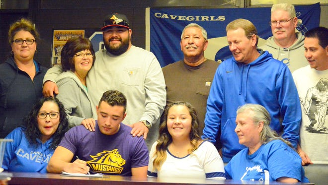 Carlsbad defensive end Isaiah Perez signs with Western New Mexico's football program on Thursday.
