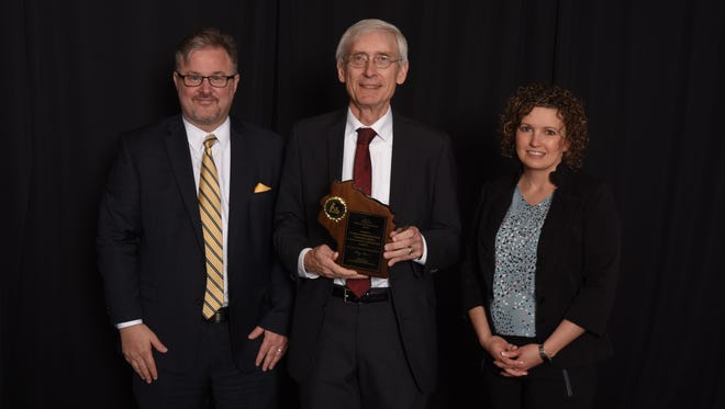 State Superintendent Tony Evers, center, recognized Dr. Vance Dalzin, Oakfield District administrator and Becky Doyle, Oakfield Elementary principal, for receiving Wisconsin Title I School of Recognition honors for the 2016-17 school year.