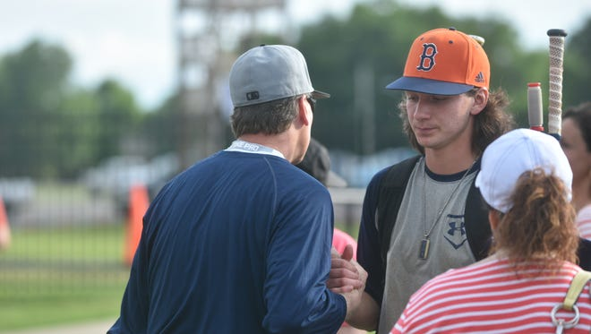 Eric Sutley greets his son Ty Sutley after Beech lost to Jefferson County 2-1 in the first round of the state AAA baseball tournament. Eric is a former state champion himself.