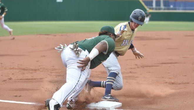 Briarcrest third baseman DJ Robinson tries to tag out Jake Rucker during the second inning.