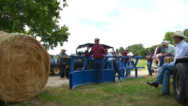 Dr. Larry Redmon, Texas A&M AgriLife Extension Service state forage specialist from College Station, discusses hay storage options at a forage field day.
