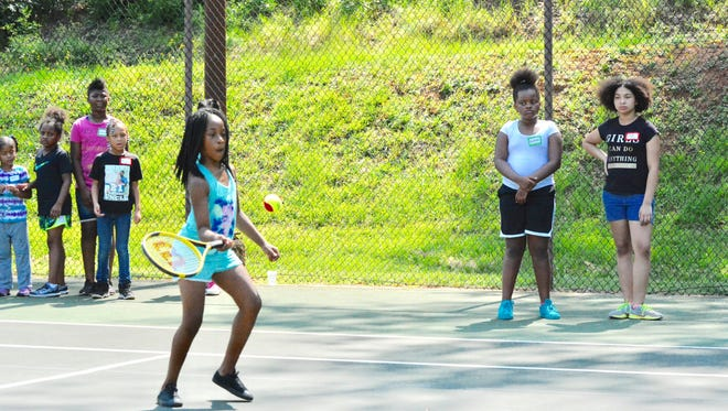 Power Is Giving offered free tennis camps to youths in Greenville and Spartanburg community centers.