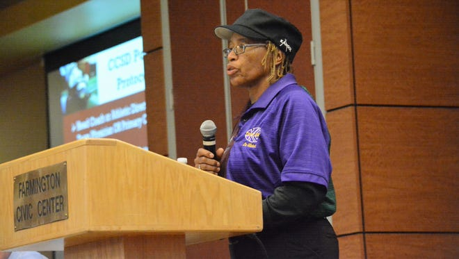 Dr. Deborah Waters, who works in sports medicine with Shiprock, Kirtland Central and Newcomb schools, addresses concussions during Friday's concussion symposium at Farmington Civic Center.
