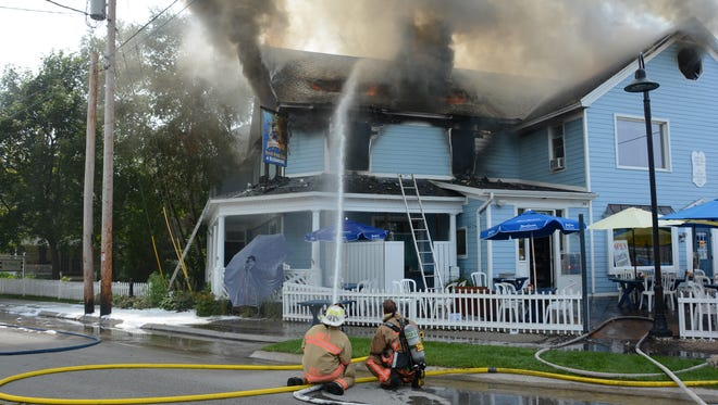 Smoke billows from the second floor of Shipwrecked Pub in Egg Harbor Sunday, Aug. 20.