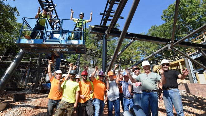On Tuesday, Sept. 19, a mix of Silver Dollar City maintenance and construction workers and outside contractors briefly celebrate the laying of the final track for a new roller coaster due to open next year, Time Traveler.