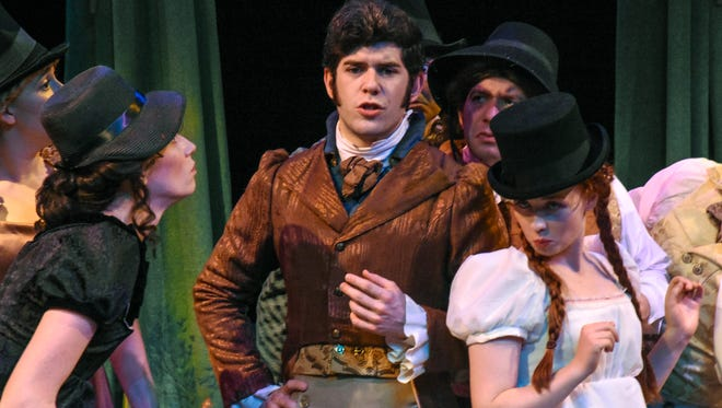 """Alex Kass (center) and the cast of Southwest Shakespeare's """"Sense and Sensibility."""""""
