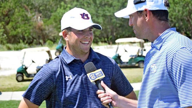 Auburn freshman golfer Wells Padgett talking to SEC Network after making the match-winning putt over Alabama Sunday.