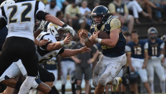Gulf Breeze running back Ty Dittmer breaks free for one of his long gains in Friday night's spring game against Milton.