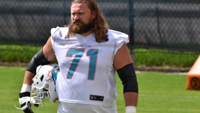 Pensacola's Josh Sitton works out with teammates May 23 during the Miami Dolphins OTA session at their training facility, Baptist Health South Florida Training Facility near Fort Lauderdale