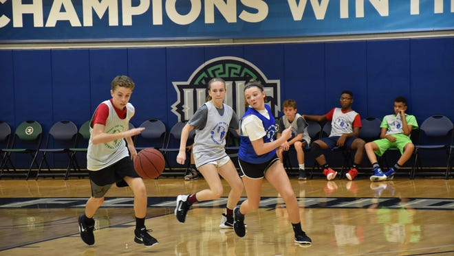 Boys and girls players compete together Wednesday during the fourth annual UWF Shoot For The Stars youth basketball camp at the UWF Field House.
