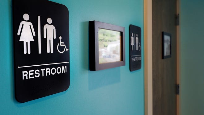 Unisex signs hang outside bathrooms at Toast Paninoteca on May 10, 2016 in Durham, N.C.