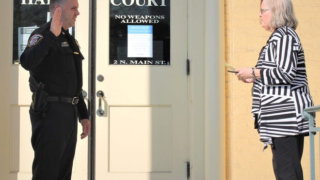 New Canandaigua Police Chief Mathew Nielsen is sworn in by City Clerk/Treasurer Nancy Abdallah in front of City Hall.