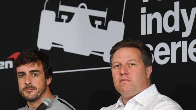 Apr 23, 2017; Birmingham, AL, USA; Formula One star Fernando Alonso and executive director of the McLaren Technology Group Zak Brown listen to a question during a press conference prior to the Honda Indy Grand Prix of Alabama at Barber Motorsports Park.