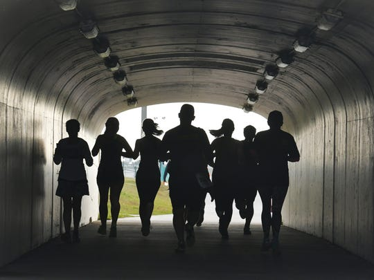 Runners in the pedestrian tunnel under Stadium Parkway as they soon approach the finish line. The Health First Fight Child Hunger 5K Run/Walk began at Viera High School stadium at 8:00am Saturday, January 13. This event is in partnership with the Children's Hunger Project and the Sharing Center of Central Florida.