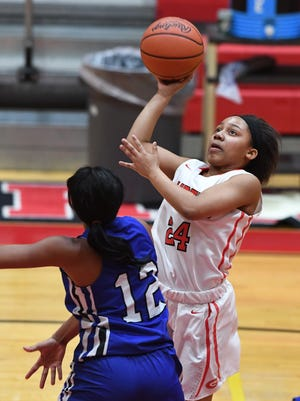 Greenville's Breanna Goodjoines (24) shoots over Eastside's Taylor Thompson (12) during the second round of the Girls AAAA playoffs on Friday, February 17, 2017.