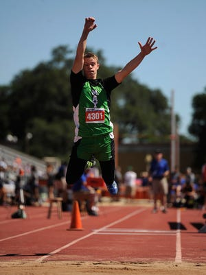 May's Jacob Brown (4301) leaps into the pit in the Class 1A boys triple jump during the UIL State Track and Field Championships on Friday, May 12, 2017, at Mike A. Myers Stadium in Austin. Brown finished third in the event with a jump of 43-1.