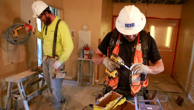 Kevin Nelson, front, of DKD Electric, and Nathan Boyles of Rob Boyles Co., work on the fourth floor of San Juan Regional Medical Center on Feb. 10 in Farmington.