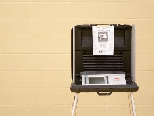 635899248312617823-votingmachine.jpg