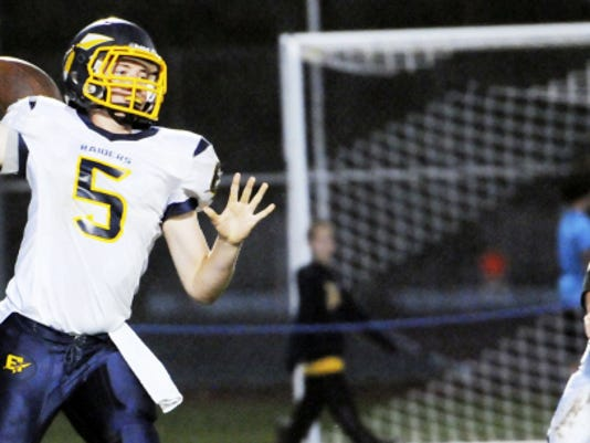 Elco quarterback Jeff Martin fires one of his touchdown passses during the Raiders' last win against the Vikings in 2013.