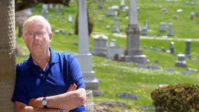 Noel Stegner of Fort Thomas stands in Evergreen Cemetery in Southgate, where his grandson, Nicholas Specht, who died of a heroin overdose, is buried. He and his family are working to make the drug Naloxone, which counteracts opioid overdose, more available to first responders.
