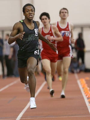 Rush-Henrietta's Paul Henry competes in the 1,000 meter Class A race at the Section V Classes A and B Winter Track and Field Championships Feb. 19 at RIT.