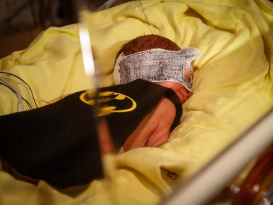 Callen Johnston wears a Batman cape and mask on Thursday,