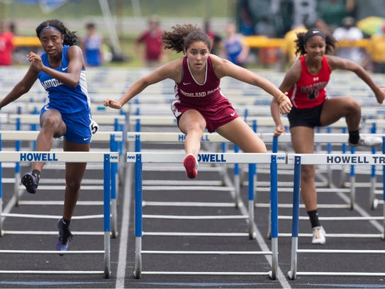 Highland Park's Julia Marks (far right) edges Middlesex's Jeanette Jones  in the Group I girls 100 hurdles. Jones helped lead Middlesex to the team title.