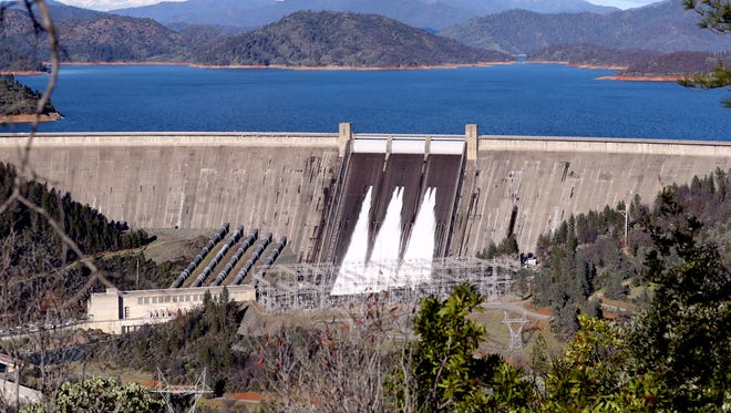 Water is released last year from Shasta Dam into the Sacramento River. A proposal to raise the height of Shasta Dam would mean inundating part of the McCloud River.