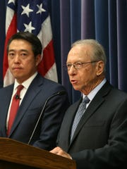 In this Aug. 17, 2017 file photo, Dutchess County District Attorney William Grady speaks about the recent arrest of Poughkeepsie gang member, as he stands alongside Joon H. Kim, then acting United States attorney for the Southern District of New York at the federal courthouse in White Plains.