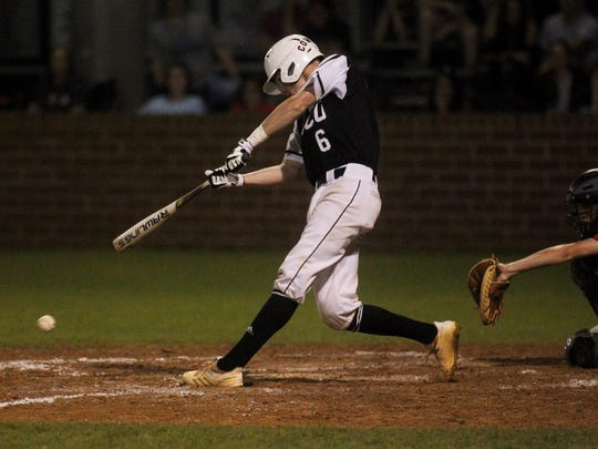 Madison County's Dustin Bass laced an RBI single through