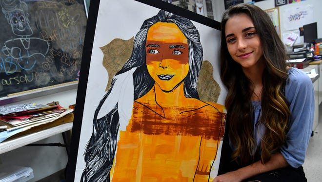 Wylie High School senior Audrey Orson with a self portrait she created in art class. Orson will graduate Friday, and plans to attend Texas Tech University.